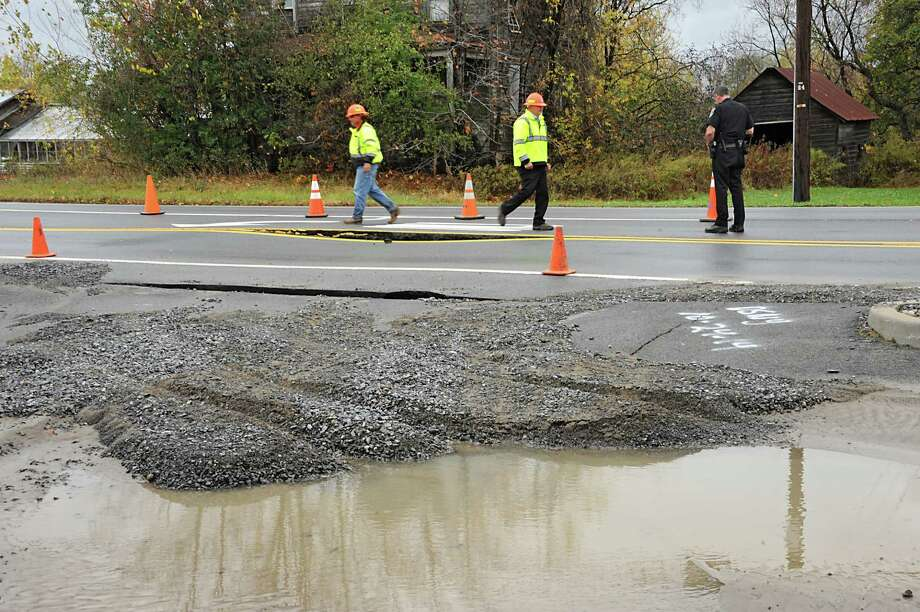 Freemans Bridge Rd. between Dutch Meadows Ln & Maple Ave. is closed to traffic due to a water main break on Friday, Oct. 24, 2014, in Glenville, N.Y.  (Lori Van Buren / Times Union) Photo: Lori Van Buren / 00029199A