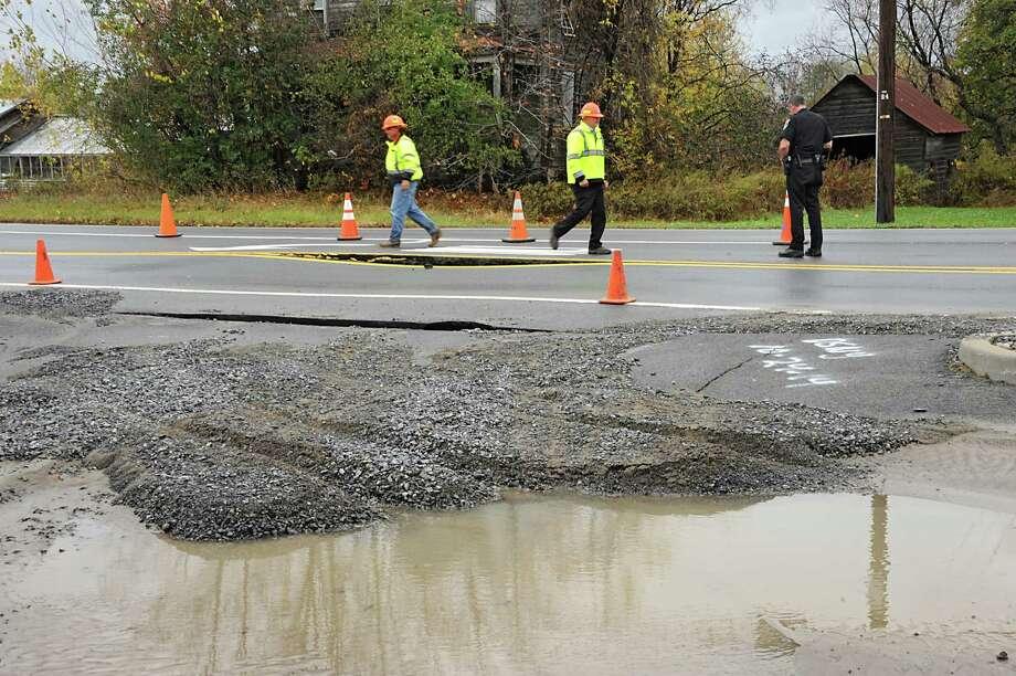 Freemans Bridge Rd. between Dutch Meadows Ln & Maple Ave. is closed to traffic due to a water main break on Friday, Oct. 24, 2014, in Glenville, N.Y.  (Lori Van Buren / Times Union) Photo: Lori Van Buren / 00029199A