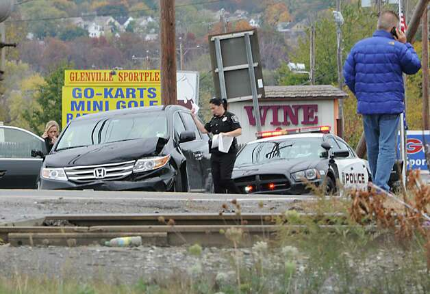 A police officer handles a traffic accident as Freemans Bridge Rd. between Dutch Meadows Ln & Maple Ave. is closed to traffic due to a water main break on Friday, Oct. 24, 2014 in Glenville, N.Y.  (Lori Van Buren / Times Union) Photo: Lori Van Buren / 00029199A