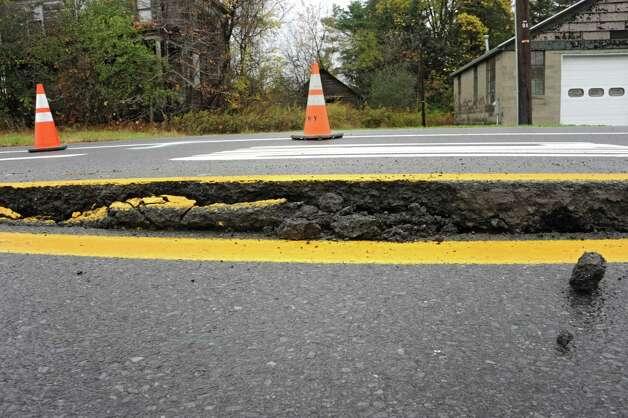 Freemans Bridge Rd. between Dutch Meadows Ln & Maple Ave. is closed to traffic due to a water main break on Friday, Oct. 24, 2014 in Glenville, N.Y.  (Lori Van Buren / Times Union) Photo: Lori Van Buren / 00029199A