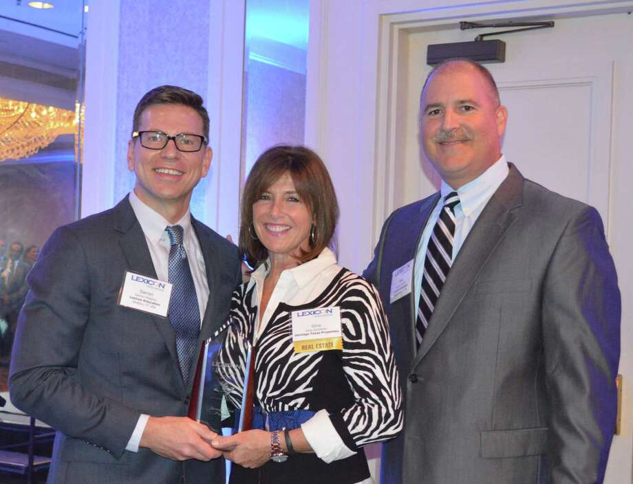 Left to right are Darren Wagner, CRP, GMS-vice president, Real Estate Services, Lexicon Relocation; Gina Schoener, CRP, GMS–client service manager, Heritage Texas Properties; and Michael Mancini, CRP, GMS–president and COO, Lexicon Relocation with the award.