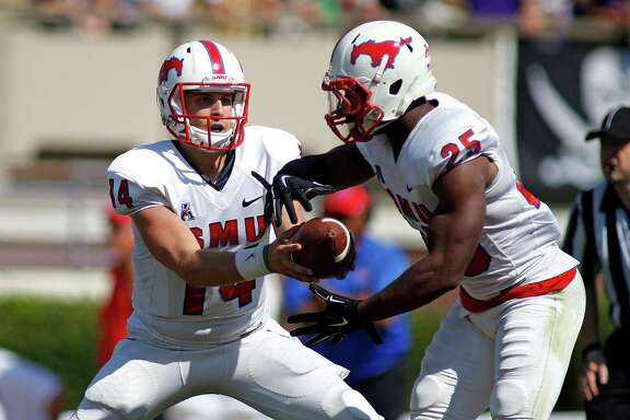 Southern Methodist quarterback Garrett Krstich (14) hands the ball off to running back K.C. Nlemchi (25)during the first half of an NCAA college football game in Greenville, N.C., Saturday, Oct. 4, 2014. (AP Photo/Karl B DeBlaker)