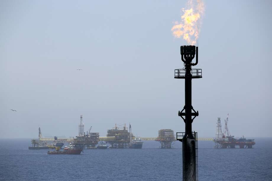 Gas is flared from a tower on an oil drilling rig operated by Petroleos Mexicans (Pemex) in the Ku-Maloob-Zaap oilfield at Campeche Bay off the coast of Ciudad del Carmen, Mexico. Mexico's Senate implemented a constitutional overhaul in Aug. 2014 ending Pemex's exclusive right to crude oil production, now in its 76th year. (Susana Gonzalez/Bloomberg) Photo: Susana Gonzalez, Bloomberg