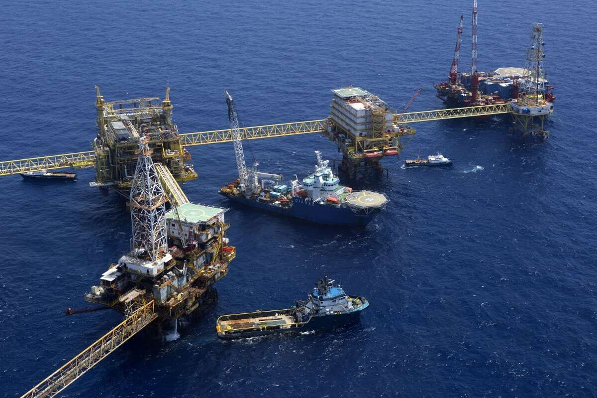 Oil drilling rigs operated by Petroleos Mexicans (Pemex) stand in the Ku-Maloob-Zaap oilfield at Campeche Bay.