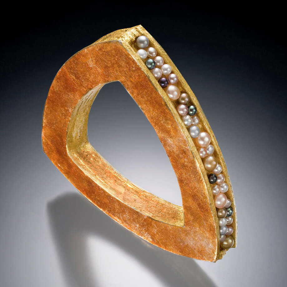This bangle bracelet is one of the fine-jewelry designs by Keith Lewis, who will be one of the vendors at CraftWestport Nov. 8 and  at Staples High Schol. Lewis uses all natural materiall in his jewelry. Westport CT.October 2014. Photo: Westport News/Contributed Photo / Westport News