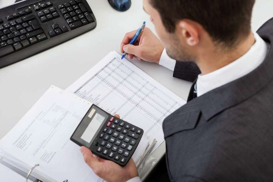 Tax accountants work for businesses, nonprofit organizations, clients of public accounting firms, or taxing authorities such as the IRS. / iStockphoto