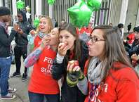 UAlbany students bite into apples during the inaugural NY Campus Crunch in which students on campuses across New York State will take a collective bite out of New York State apples on Food Day, Friday, October 24, 2014, in Albany, NY.  (John Carl D'Annibale / Times Union)
