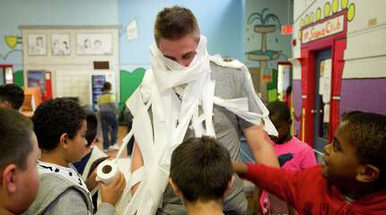 Andy Parr is made into a mummy during a Fall Festival Celebration hosted by NBC Sports Group at the Boys and Girls Club in Stamford, Conn., on Friday, October 24, 2014.