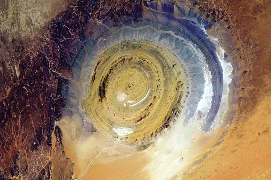 "The Richat Structure in Mauritania, also known as the Eye of the Sahara, is a landmark for astronauts. ""This bull's-eye orients you, instantly,"" Chris Hadfield writes in his new book, ""You Are Here."" Photo: Chris Hadfield"