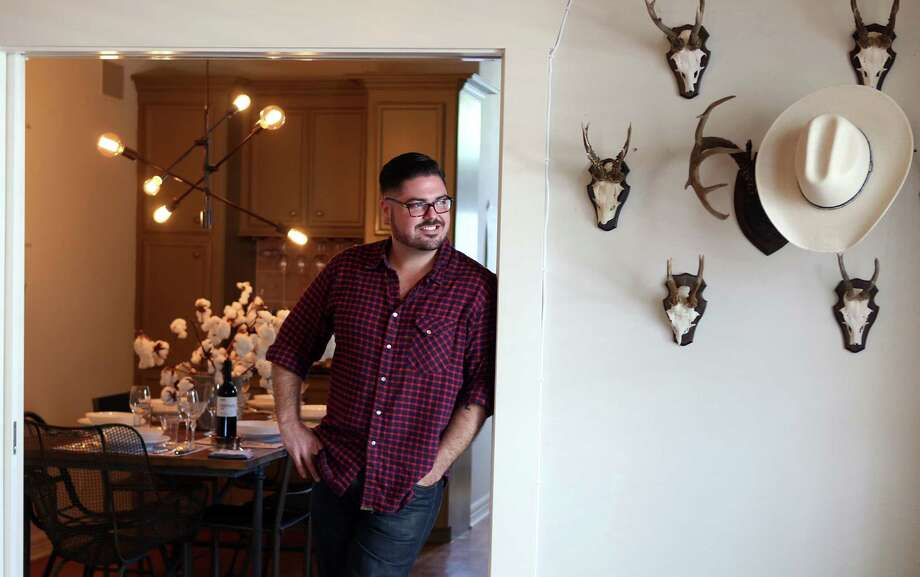 Morgan Weber, co-owner of Revival Market and Coltivare, stands near a display of roe deer antlers from the 1920s in his Heights bungalow. The hat hangs on turn-of-the-century South Texas white tail deer antlers. Photo: Mayra Beltran, Staff / © 2014 Houston Chronicle