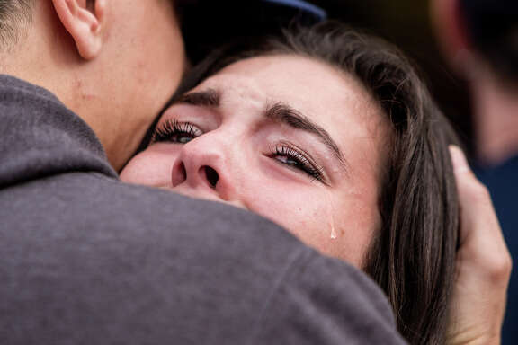 Tearful students are reunited with friends and family outside of a reunification center at Shoultes Christian Assembly Church near the scene of a school shooting that left two dead and four wounded Friday, October 24, 2014, at Marysville Pilchuck High School in Marysville, Washington. Several students identified the shooter as Jaylen Fryberg. Providence Regional Medical Center in Everett took in the wounded.