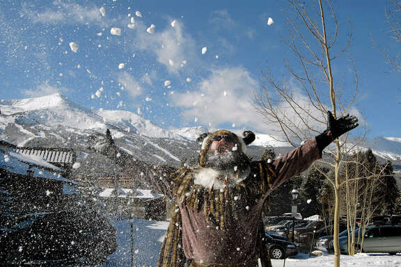 A man dressed as Ullr the Norse God of Snow plays with fresh snow during the Ullr Fest Celebration in Breckenridge, Colo.