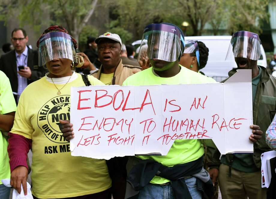 """Demonstrators with the United African Congress (UAC) hold a rally for the """"Stop Ebola"""" movement in New York on October 24, 2014 the morning after it was confirmed that Doctor Craig Spencer, a member of Doctors Without Borders, who recently returned to New York from West Africa tested positive for Ebola, making him New York City's first Ebola patient. AFP PHOTO / Timothy A. ClaryTIMOTHY A. CLARY/AFP/Getty Images Photo: TIMOTHY A. CLARY, Staff / AFP"""