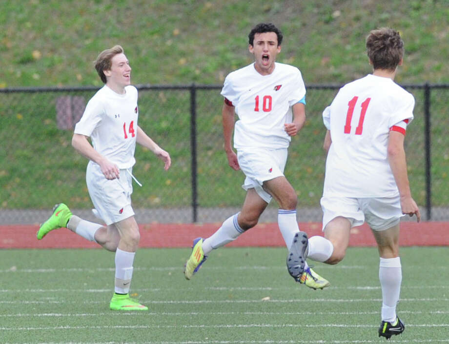 Paul Quiroga (#10) of Greenwich reacts after netting the third goal of the game during the boys high school FCIAC soccer quarterfinal match between Westhill High School and Greenwich High School at Greenwich, Conn., Friday afternoon, Oct. 24, 2014. Congratulating him are his Greenwich teammates, Liam Tracey (#14), left, and Daniel Ozizmir (#11). Greenwich advanced to the semifinal round with a 4-1 victory over Westhill. Photo: Bob Luckey / Greenwich Time