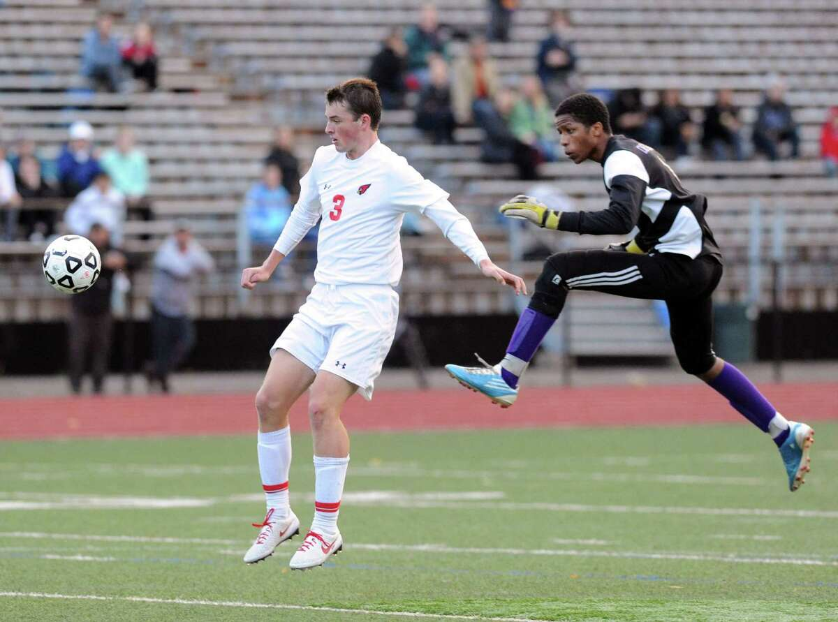 At left, Nick Bartels (#3) of Greenwich gets past Westhill goal keeper Juan Dela Cruz to score the fourth and final goal of the game during the boys high school FCIAC soccer quarterfinal match between Westhill High School and Greenwich High School at Greenwich, Conn., Friday afternoon, Oct. 24, 2014. Greenwich advanced to the semifinal round with a 4-1 victory over Westhill.