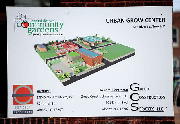 Sign on the exterior of the Urban Grow Center, a onetime abandoned shirt collar factory building on Monday, Oct. 20, 2014 in Troy, N.Y. The Urban Grow Center is under construction and will be the future headquarters for the Capital District Community Gardens. (Lori Van Buren / Times Union) Photo: Lori Van Buren / 10029069A