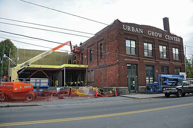 Exterior of the Urban Grow Center, a onetime abandoned shirt collar factory building on Monday, Oct. 20, 2014 in Troy, N.Y. The Urban Grow Center is under construction and will be the future headquarters for the Capital District Community Gardens. (Lori Van Buren / Times Union) Photo: Lori Van Buren / 10029069A