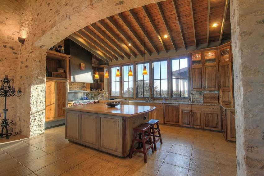 Alexandria Ranch in Comfort sleeps 12 guests in its main home and two casitas. Features include a gourmet kitchen, butler's pantry, dining area, great room and three fireplaces, as well as the option of a personal chef. Prices range from $1,299 to $1,499 a night, excluding fees. Source: HomeAway