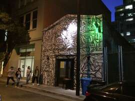 Built in 1913 for a blacksmith, the brick building tucked down an alleyway at 90 Natoma St. has seen several lives -- currently that of a popular bar, Natoma Cabana, with the front facade covered by a mural by Ian Ross.