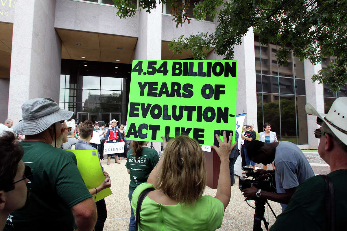 Demonstrators hear speakers from the Texas Freedom Network at a rally as the State Board of Education conducts a public hearing regarding content in textbooks, including science textbooks, on September 17, 2013.