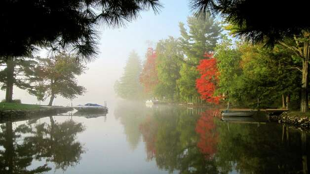 "Cooler weather provides for some amazing morning shots, like this one on Second Burden Lake in Averill Park, says Linda Brown. ""My camera is always at the ready in the fall, when the ever-changing colors, the morning mist and the dappled sunlight take their turns creating beautiful landscapes. I never tire of watching the show."" (Linda Brown)"