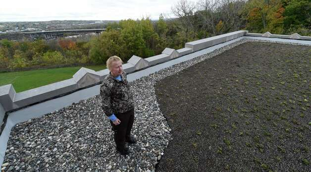 "Head of school Pamela Clark looks over the planting of some of the hundreds of grasses and perennials on the mammoth ""green roof"" on the top of Doane Stuart School Wednesday afternoon Oct. 22, 2014 in Rensselaer, N.Y.    (Skip Dickstein/Times Union) Photo: SKIP DICKSTEIN / 00029195A"