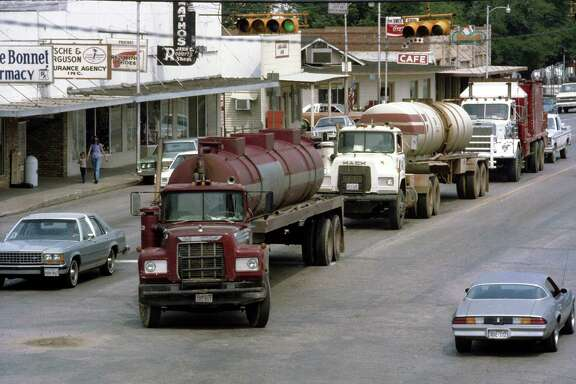 Oil trucks still roll down the main streets of Giddings, but life has begun to settle down.