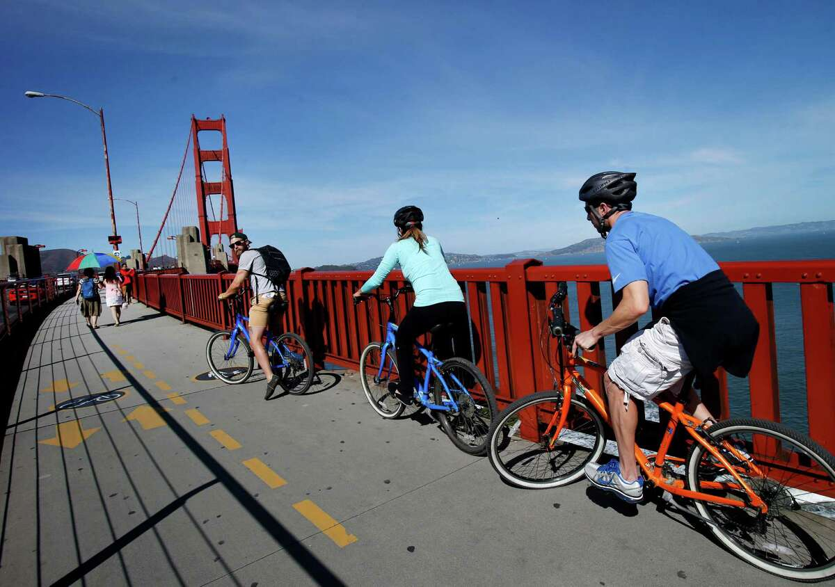 Cyclists prepare to cross the Golden Gate Bridge from the south side Tuesday October 21, 2014.