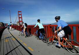 Cyclists prepare to cross the Golden Gate Bridge from the south side Tuesday October 21, 2014. Officials at the Golden Gate Bridge are again considering charging tolls for pedestrians and cyclists.