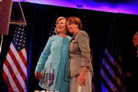 Former Secretary of State Hillary Rodham Clinton (l to r) and House Minority Leader Nancy Pelosi hug on stage after both spoke at the DCCC Ultimate Women's Power Lunch at the Fairmont Hotel  on Monday, October 20, 2014 in San Francisco, Calif.