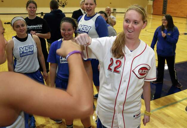 Lauren Hill gets congratulation from a teammate after practicing with her NCAA college basketball team at Mount St. Joseph University in Cincinnati on Thursday, Oct. 23, 2014. She's got only a few months to live, and she's spending a good part of it on the basketball court getting ready for her one shining moment. (AP Photo/Tom Uhlman) ORG XMIT: OHTU202 Photo: Tom Uhlman / FR31154 AP
