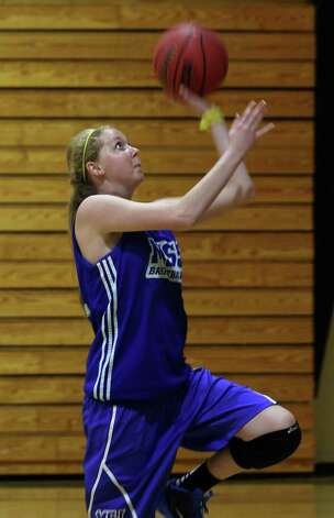 Lauren Hill puts in a layup as she practices with her NCAA college basketball team at Mount St. Joseph in Cincinnati on Thursday Oct. 23, 2014. The NCAA allowed Mount St. Joseph's season opener to be moved up to Nov. 2, so that Hill, who has an inoperable brain tumor, will be able to play in a college basketball game. (AP Photo/Tom Uhlman) ORG XMIT: OHTU207 Photo: Tom Uhlman / FR31154 AP