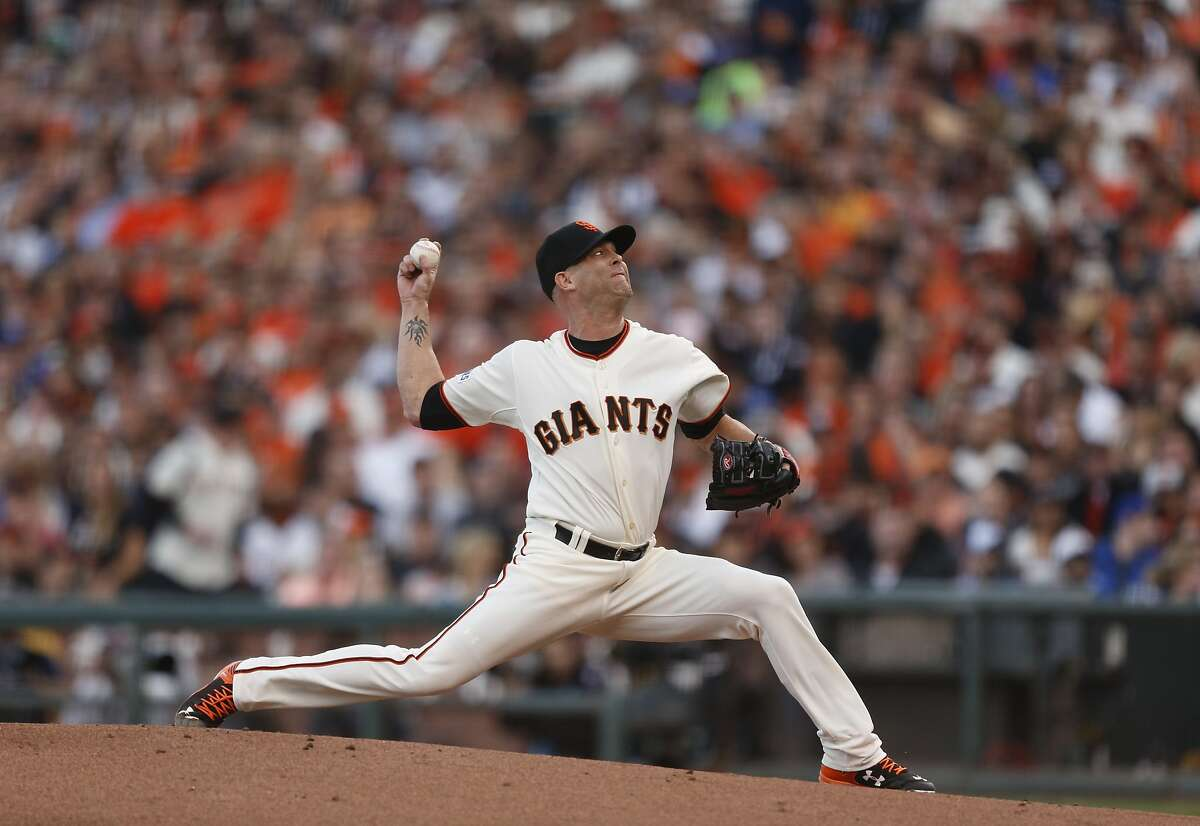 Giants Tim Hudson pitches in the first inning during Game 3 of the World Series at AT&T Park on Friday, Oct. 24, 2014 in San Francisco, Calif.