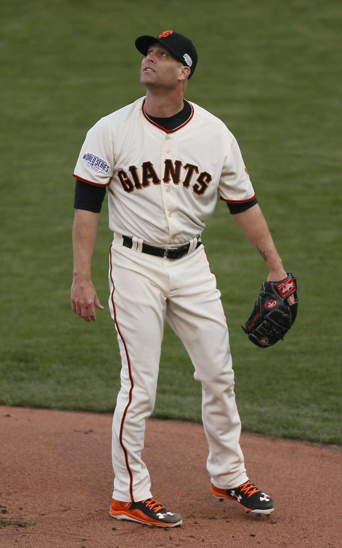 Giants Tim Hudson watches a double by Royals Alcides Escobar in the first inning during Game 3 of the World Series at AT&T Park on Friday, Oct. 24, 2014 in San Francisco, Calif.