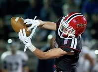 New Canaan's Michael Kraus makes a catch during Friday's football game against Staples at New Canaan High School on October 24, 2014.