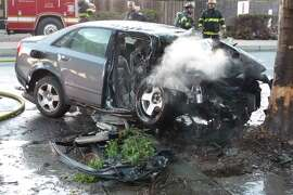 Police officers rescued an unconscious woman from the wreckage of this car while it was aflame after it crashed into a tree in Newark on Oct. 23, 2014.