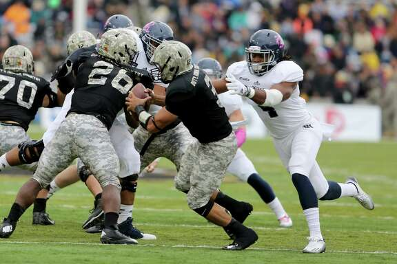 Alex Lyons (4) was part of a Rice defense that had 13 tackles for 37 yards in losses against Army on Oct. 11.