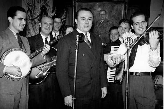 """W. Lee """"Pappy"""" O'Daniel, center, backed by Pat O'Daniel and His Hillbilly Boys, broadcast their radio show on the Texas State Network."""