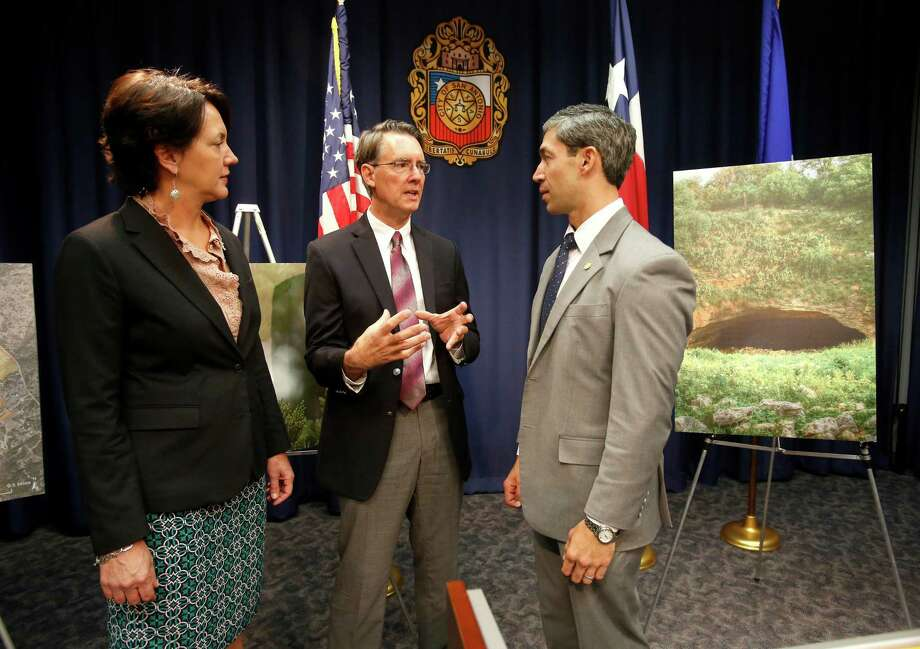 Councilman Ron Nirenberg, right,, The Nature Conservancy state director Laura Huffman, left, and Bat Conservation International executive director Andrew B. Walker speak about the purchase of 1,500 acres of land near the Bracken bat cave for conservation purposes. Photo: William Luther / William Luther / San Antonio Express-News / © 2014 San Antonio Express-News