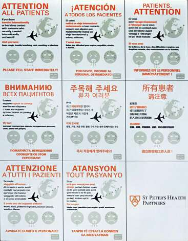 A multilingual Ebola warning sign outside the St. Peter's Hospital emergency room Friday Oct. 24, 2014, in Albany, NY.  (John Carl D'Annibale / Times Union) Photo: John Carl D'Annibale