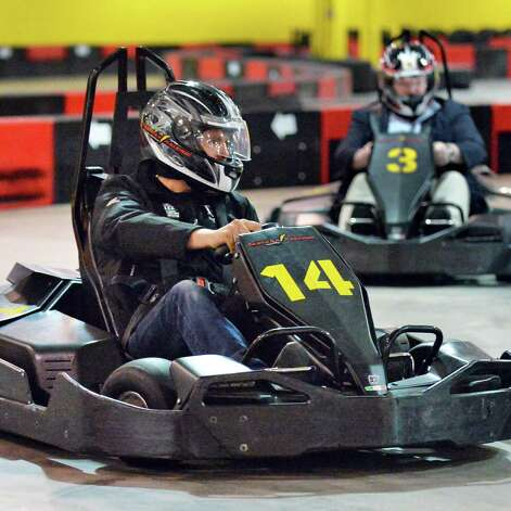 David Zecchini, left, leads Times Union writer Steve Barnes in a go-cart race at FasTrax Raceway in Crossgates Commons Tuesday July 29, 2014, in Albany, NY.  (John Carl D'Annibale / Times Union) Photo: John Carl D'Annibale / 00027899A