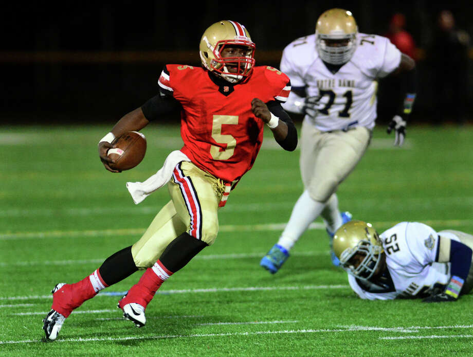 Stratford's Gueber Docteur carries the ball, during football action against Notre Dame of Fairfield in Stratford, Conn. on Friday October 24, 2014. Photo: Christian Abraham / Connecticut Post