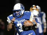 Newtown's Nicholas Rubino (34) heads downfield during the Brookfield at Newtown High School boys football game, Friday night, October 24, 2014, in Newtown, Conn.