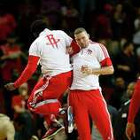 Houston Rockets guard Patrick Beverley (2) and Francisco Garcia (32) during the player introductions before the start of an NBA basketball game at the Toyota Center, Friday, Oct. 24, 2014, in Houston.