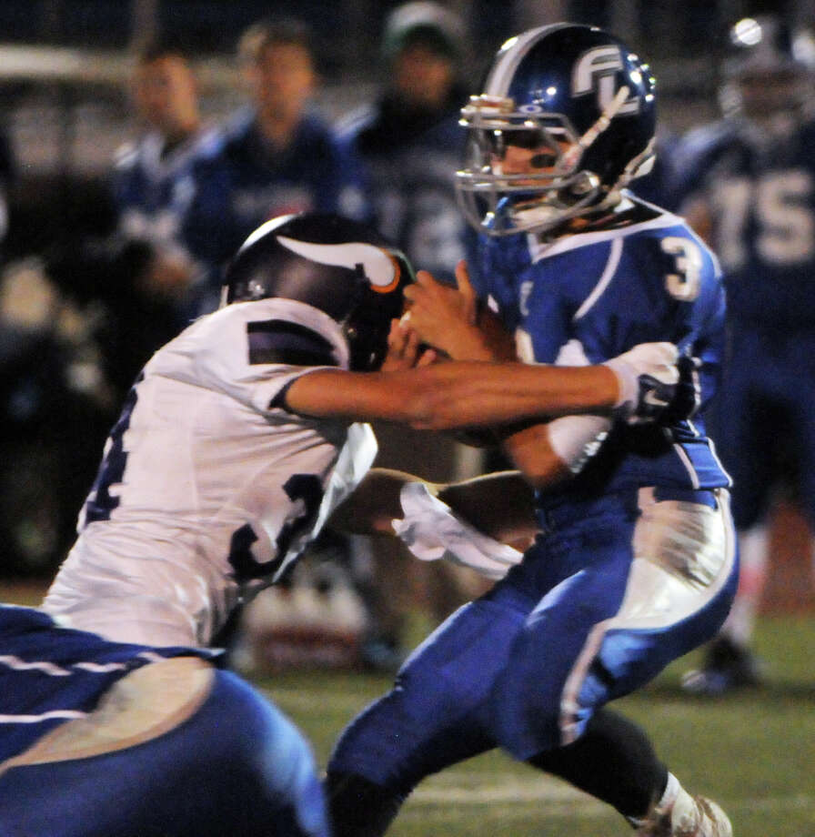 Westhill's Joe Schlessinger greets Ludlowe QB Bryan Pacewicz with a sack as Ludlowe High School hosts Westhill in a football game in Fairfield, Conn., Oct. 24, 2014. Photo: Keelin Daly / Stamford Advocate Freelance