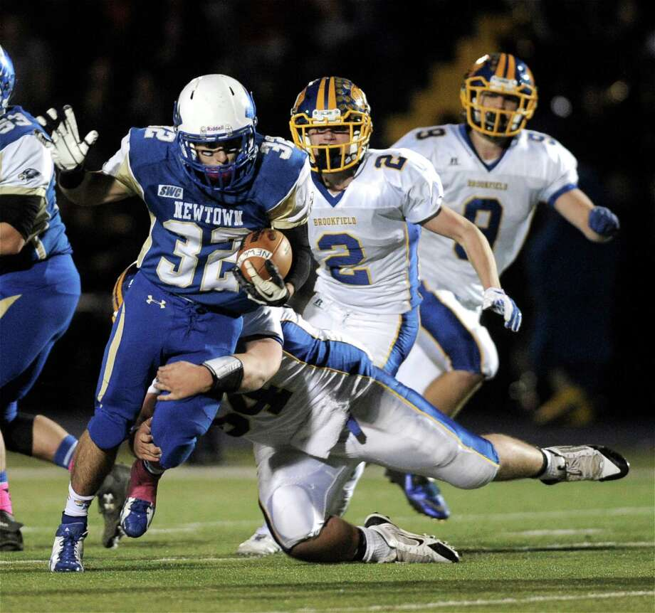 114 yards and a TD on 21 rushes in 21-14 victory over Brookfield in a battle of unbeatens. Added a sack on defense. Photo: H John Voorhees III / The News-Times Staff Photographer