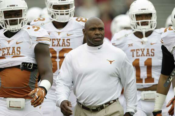 Texas head coach Charlie Strong walks on the field before an NCAA college football game  against Oklahoma at the Cotton Bowl, Saturday, Oct. 11, 2014, in Dallas. (AP Photo/LM Otero)