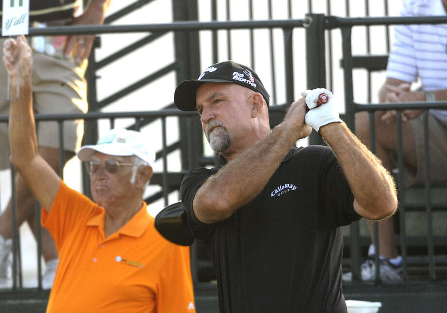 Marco Dawson watches his tee shot during the opening round. Dawson, who has never won on the PGA or Champions tours since turning pro in 1985, is tied with John Cook for the lead. Photo: Billy Calzada / San Antonio Express-News
