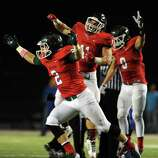 The Woodlands defensive back TC Schneider (2) and teammates celebrate a fumble recovery during the first half of a high school football game against Oak Ridge, Friday, October 24, 2014, at Woodforest Stadium in Shenandoah.