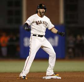 Giants Michael Morse reacts after hitting an RBI double in the sixth inning during Game 3 of the World Series at AT&T Park on Friday, Oct. 24, 2014 in San Francisco, Calif.